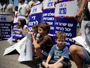 Protesting a Neighbor: Children in Israel gather outside of the Russian embassy in Tel Aviv to protest the use of chemical weapons in Syria.