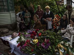 Relatives of Alexey Vorobyov, a pro-Russian activist killed during fierce fighting between Ukrainian troops and pro-Russian rebels three days ago, mourn at his funeral.