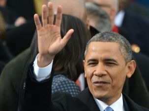 Second Term: President Obama waves to crowd as his inauguration in Washington D.C.