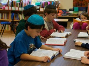 Daily Minyan: Third graders read from their prayer books at the Lander Grinspoon Academy in Northampton, Mass., where enrollment has increased, bucking the national trend.