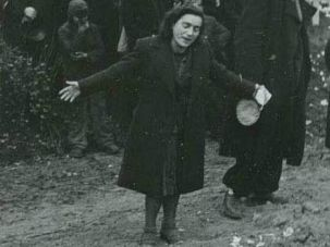 Place of Grief: A woman mourns at the site of a Nazi concentration camp in Belgrade.