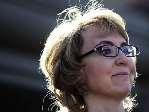 Homecoming: Ex-Rep. Gabby Giffords called for new gun laws in an emotional return to the spot where she was nearly killed in a shooting rampage.
