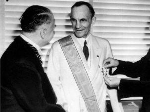 Henry Ford receives award from German diplomats in 1938.