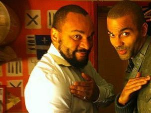 Controversial French comic Dieudonne Mbala-Mbala poses with basketball star Tony Parker.