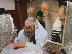 Tradition? Rabbi Avrohom Cohn performs a bris at a synagogue in Brooklyn's Boro Park. He says he performed the controversial metzitzah bpeh ritual, but did not get consent from the parents.
