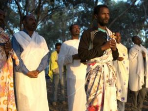 Let My People Come: African asylum seekers pray after spending the night in an outdoor camp near Nitzana border crossing with Egypt in the Negev Desert.