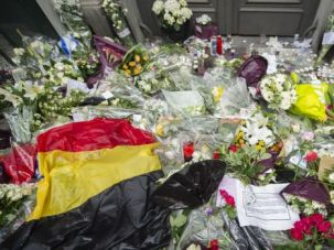Sorrow Site: A makeshift memorial is growing outside the Jewish Museum in Brussels after a deadly shooting rampage over the weekend.