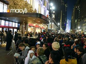 Big Deals: Black Friday shoppers gather at midnight outside New York?s Macy?s department store.