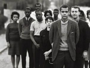 Dorothy Zellner, center, stands behind civil rights leader Julian Bond.