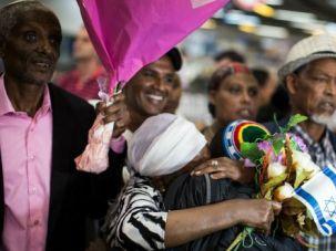 Welcome to Israel: Israeli relatives welcome Ethiopian Jews arriving in Tel Aviv.