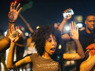 Standing Their Ground: Demonstrators protesting the killing of teenager Michael Brown by a Ferguson police officer are hit by tear gas.