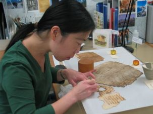 By Hand and Machine: Lucy Cheng works to preserve fragments from the Cairo genizah at Cambridge University in Britain.