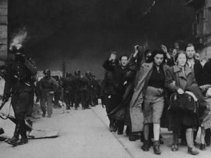 Nazi Horror: Nazi soldiers force Jews from their homes in the Warsaw ghetto.