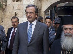 No Kippah: Greek Prime Minister Antonis Samaras visits the Church of the Holy Sepulchre in Jerusalem. When he got to Yad Vashem, he refused to don a yarmulke.