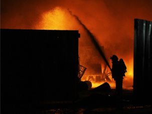 Put Out the Fire: Israeli firefighters extinguish a burning factory hit by a rocket fired from the Gaza Strip at an industrial zone in the southern city of Sderot.