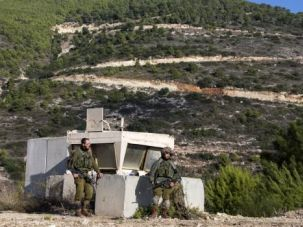Israeli soldiers take position on the Israeli-Lebanese border.