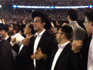 Happy Moment: Orthodox young men celebrate the Daf Yomi at a packed New Jersey stadium.