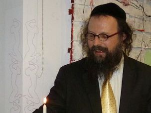 Ousted: Former Krakow Chief Rabbi Boaz Pash, shown lighting a Hanukkah candle in 2010, was known for his outreach and openness.