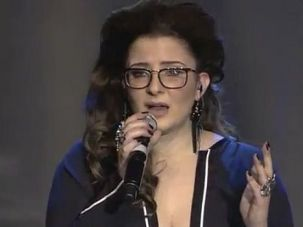 Tone Deaf: Israeli Moran Mazor belts out a song in the annual Eurovision singing competition. She wanted to wear a dress designed by John Galliano, but was ordered to avoid the controversial coutier.