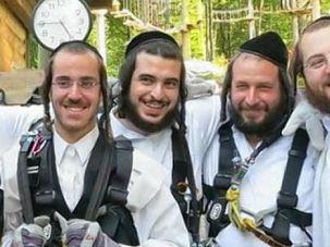 Better Days: Slain developer Menachem Stark, second from the right, enjoys joke with relatives.