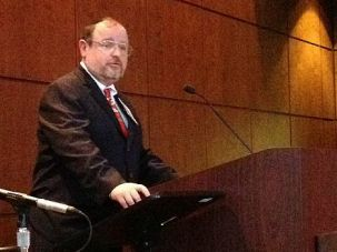 No Comment: Rabbi Michael Broyde speaks at a conference on Jewish and Islamic law in Chicago. He had little to say about the fake name scandal that has erupted in recent days.