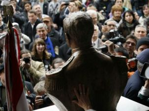 Hitler?s Hungarian: Demonstrators and journalists surround a bust of Hungary?s Nazi-era leader Miklos Horthy.