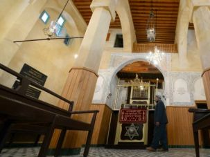 Ancient Roots: Moroccan Jew walks to the door of a synagogue in the northern city of Fez. A museum devoted to the country?s Jewish culture has reopened after renovations.