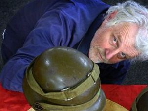 Kiwi Outrage: Auction house official displays Nazi memorabilia going on block in New Zealand.
