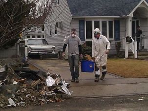 Little Known: Volunteers from Nechama help cart debris from the ruined ground floor of Messler?s home in Oceanside, L.I.