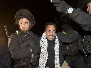 E1 Eviction: Israeli security forces bundle a Palestinian protester into custody Sunday at a tent city in the E1 section of the occupied West Bank.