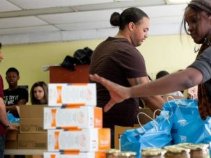 Poverty Amid Plenty: Volunteers pack up food packages at a popup Passover food pantry in Brooklyn. Surprising numbers of Jews are seeking help, even those who once considered themselves middle-class.