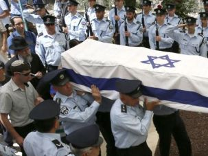Unhappy Holiday: Israeli police officers carry the coffin of slain Chief Superintendent Baruch Mizrahi, who was shot in an ambush on the eve of Passover.