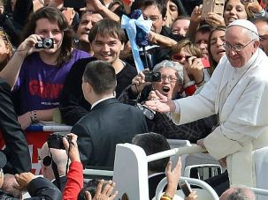 Holy Days:Pope Francis greets well-wishers on Easter Sunday in Rome.