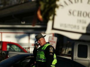 Save the Children: A police officer stands guard after shootings at Sandy Hook school in Newtown, Conn. Jewish schools should wake up to the danger and implement security training immediately.