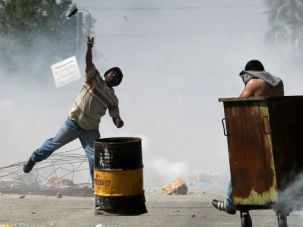 West Bank Unrest: Palestinian youths battle soldiers after a Jewish settler was accused of beating an Arab with steel pipes.