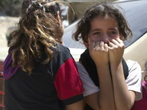 'Telegenic'? Palestinian girls mourn before the funeral of their uncle, who died in an Israeli airstrike in Gaza City.