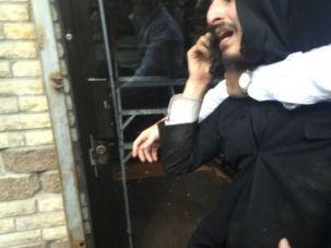 Hustled Away: Zimmerman was protesting Satmar Hasidic community leader David Niederman when he was hustled into a Judaica shop by Satmar activists.
