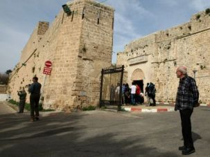 Mixed Company: Tourists and locals walk near Akko's Old City walls in 2010.