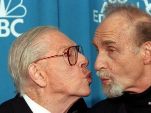 Milt and Sid: Milton Berle puckers up for comic pal Sid Caesar.