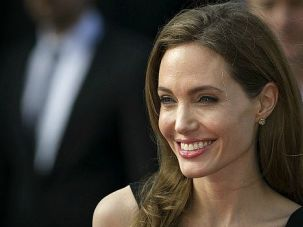 Still Stunning: Angelina Jolie smiles for fans at a movie premiere in London. The Hollywood superstar was making her first appearance since she announced she underwent a double mastectomy over breast cancer fears.