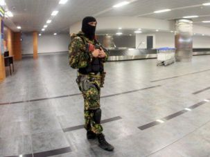 Chaos Reigns: Pro-Russia militant roams terminal in Donetsk Airport in Eastern Ukraine.