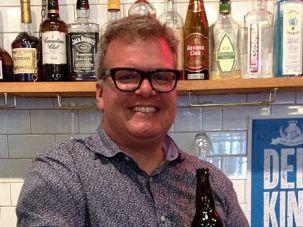 Cheers to Jew: Zane Caplansky shows off his new beer in his eponymous Toronto deli.