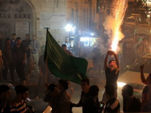 A Victory? Palestinians celebrate reports that Hamas has captured an Israeli soldier during fierce fighting in Gaza.