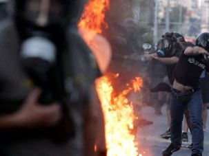Street Battle: Neo-Nazi supporters of Greece?s Golden Dawn party clash with police outside Athens.