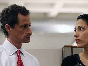 Stand by Her Man: Huma Abedin appears at a press conference with New York mayoral candidate Anthony Weiner, who vowed to stay in the race after new sext-ing accusations emerged.