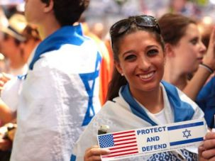 Standing for Israel: Demonstrators show support for Israel during a rally outside the United Nations in New York.