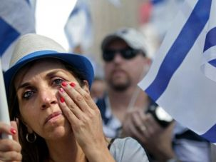 Shifting Support: A pro-Israel demonstrator attends support rally in New York. The coalition of support for Israel is shifting, a new poll reveals.