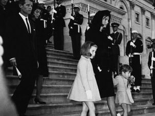 A Nation Mourns: Jacqueline Kennedy leads her children down the Capitol steps during the funeral rites for her slain husband, 50 years ago this week.