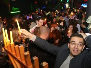 More Fun for Jew: Russian Jew lights Hanukkah candle in Moscow nightclub. A new club will cater to community with kosher menu and drinks.