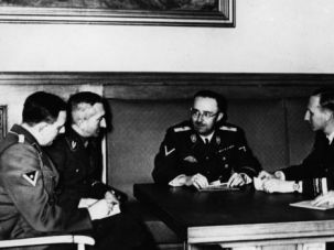 Dark Days: Gestapo boss Heinrich Muller, second from left, listens to briefing from fellow Nazis.